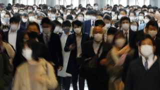 Commuters wearing protective face masks, amid the coronavirus pandemic, make their way in Tokyo, Japan. Picture: Kim Kyung-Hoon/Reuters