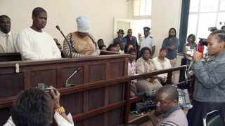 """Convicted """"sugarcane serial killer"""" Thozamile Taki, and his alleged accomplice and girlfriend Hlengiwe Nene, in the dock at the Umzinto Magistrate's Court. Nene was found not guilty and released from prison. Picture: Giordano Stolley/Sapa archive"""