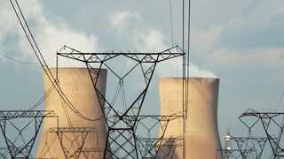 Cooling towers are pictured at a coal-based power station owned by Eskom in Duhva