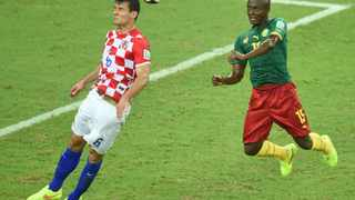Croatia's Ognjen Vukojevic vies with Cameroon's Pierre Achille Webo during their clash. A convicted match-fixer is alleged to have predicted the outcome of the game. Photo: Emmanuel Dunand