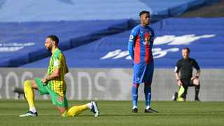 Crystal Palace's Wilfried Zaha stands as West Bromwich Albion's Matt Phillips kneels in support of the Black Lives Matter campaign before their match at Selhurst Park. Photo: Mike Hewitt/Reuters