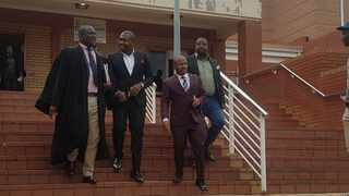Cyril Madonsela and Thulani Mdaka, middle, leave the Randburg Magistrate's Court. They both pleaded guilty to assaulting two women at Cubana in Fourways in August. Picture: Lindi Masinga/ANA