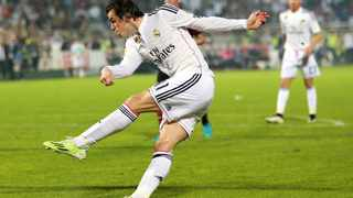 DUBAI, UNITED ARAB EMIRATES - DECEMBER 30: Gareth Bale of Real Madrid strikes at goal during the Dubai Football Challenge match between AC Milan and Real Madrid at The Sevens Stadium on December 30, 2014 in Dubai, United Arab Emirates. (Photo by Warren Little/Getty Images)
