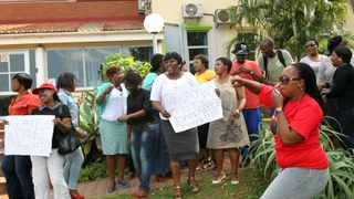 DURBAN:090413 Workers at the Child Welfare Durban and District picketing outside their offices demandind their 13th cheque after receiving notices that they wont be getting it at the end of the year. PICTURE:GCINA NDWALANE