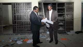 DURBAN: 260613 Mayor James Nxumalo and Dr Sibongiseni Dlomo visited Cato Crest Community hall to access damages done by the protesters. PICTURE: GCINA NDWALANE