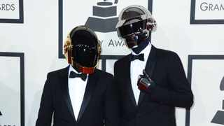 Daft Punk arrives at the 56th annual Grammy Awards at Staples Center. Picture: Jordan Strauss/Invision/AP