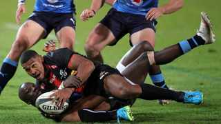 Damian Willemse of the Stormers is tackled by Madosh Tambwe of the Bulls during their Rainbow Cup SA clash. Picture: Samuel Shivambu/BackpagePix