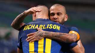 Dani Alves of Brazil celebrates with Richarlison after the match against Saudi Arabia that saw them book their place in the quarter-finals of the Tokyo Olympics. Photo: Molly Darlington/Reuters