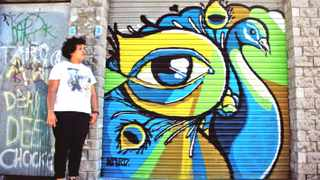"""December 2012 Graffiti artist Nadia Fisher - """"I LOVE this series of photos taken by Kent Lingeveld/No ID Photography. Painted this yesterday, outside the Alpha Longboard workshop"""""""