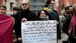 Demonstrators from Amnesty International hold placards outside the Egyptian embassy in London in 2018 in support of Giulio Regeni, who was found murdered in Cairo in 2016. File picture: Simon Dawson/Reuters