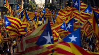 Demonstrators wave Catalan flags during a protest rally in Barcelona, Spain.
