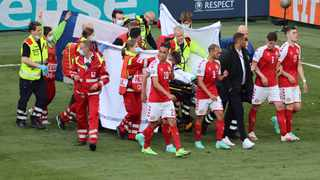 Denmark's players gather as paramedics attend to midfielder Christian Eriksen (not seen) during the UEFA EURO 2020 Group B football match against Finland.Photo: AFP
