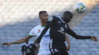 Deon Hotto of Orlando Pirates is challenged by Marouane Hadhoudi of Raja Casablanca during their Caf Champions League quarter-final first leg match at Orlando Stadium in Johannesburg on Sunday. Photo: Sydney Mahlangu/BackpagePix