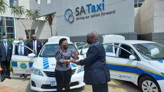 Deputy Minister in the Presidency Pinky Kekana hands over keys of patrol vehicles sponsored by SA Taxi to the chairperson of Tembisa Alexandra Taxi Association, Smarts Mhlambe. Picture: Jacques Naude/African News Agency (ANA)