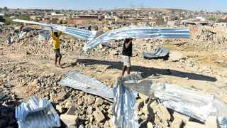 Desperate Alexandra township residents salvage what's left of their homes after illegal structures built too close to the Gautrain lines were demolished by the Red Ants. File picture: Itumeleng English/African News Agency(ANA)