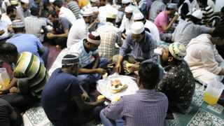 Devotees break fast on the first day of Ramadan at a mosque in Singapore. A survey ranked the Asian country as the top non-Islamic destination for Muslim tourists, weeks after official data showed overall visitor numbers fell last year for the first time since 2009. Photo: Edgar Su