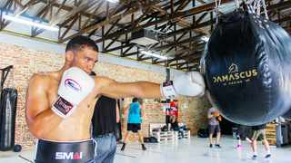 Dillon Solomons hits the punching bag during a training session. Photo: Tamryn Christians/MzansiMMA