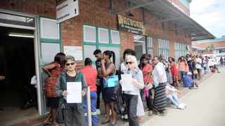 Dissatisfied citizens Verni Pillay and Jill Curran wait in a long queue at Home Affairs in Umgeni Road, yesterday. Picture: Motshwari Mofokeng/African News Agency/ANA