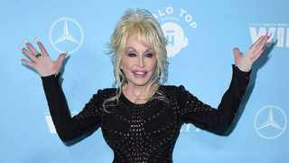 Dolly Parton arrives at the 69th Primetime Emmy Awards Variety and Women in Film pre-Emmy celebration on Friday, Sept. 15, 2017 in Los Angeles. Picture: Jordan Strauss/Invision/AP