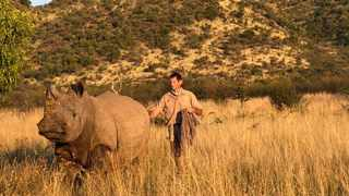 Dr Gerhardus Scheepers with a rhino bull in the Pilanesberg National Park.