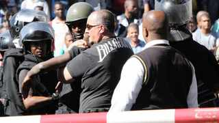 Durban 28-07-2014 A Student is beeing arrested by the Security People as they were stricking at Mangosuthu Univesity of Technology. Picture by: Sibonelo Ngcobo