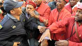 EFF MPs jostle with police after the National Assembly sitting was dramatically suspended last week. Photo: Jeffrey Abrahams
