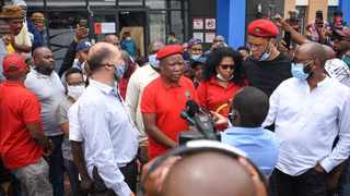EFF leader Julius Malema and Pharmacy Direct CEO Gavie Erasmus after a 'special visit' after workers alleged the company was not paying forward their UIF Ters funds. Picture: Twitter/EFFSouthAfrica