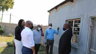 Education MEC Kwazi Mshengu, with officials, inspected the damage at one of the schools in uMlazi on Tuesday. I SUPPLIED