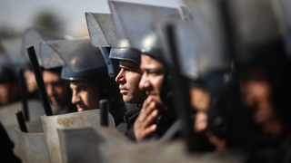 Egyptian police officers stand in front of the police academy in Cairo. Picture: Mohamed El-Shahed