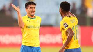 Emiliano Tade (left) celebrates a goal with Themba Zwane during the CAF Champions League match against Asec Mimosas at Loftus. Photo: Muzi Ntombela/BackpagePix