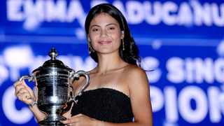 Emma Raducanu poses with her US Open trophy after defeating Leylah Annie Fernandez. Photo: Matthew Stockman/Getty Images via AFP