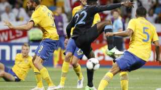 England's Daniel Welbeck scores his team's third goal against Sweden during their Group D Euro 2012 soccer match at the Olympic stadium in Kiev, June 15, 2012.