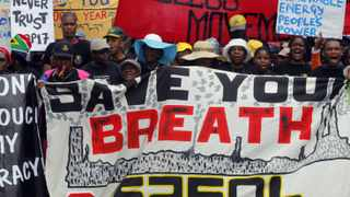 Environmental activists demonstrate outside the United Nations Climate Change conference (COP17) in Durban. The protest march was part of a Global Day of Action to demand a fair climate change deal.
