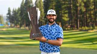 Erik van Rooyen of South Africa celebrates with the trophy after winning during the final round of the Barracuda Championship at Tahoe Mountain Club's Old Greenwood Golf Course on Sunday. Photo: Alex Goodlett/Getty Images/AFP
