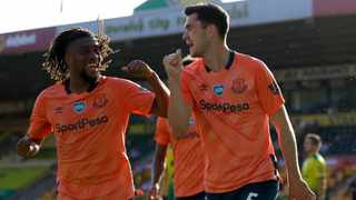 Everton's Michael Keane, right, and Everton's Alex Iwobi celebrate scoring their side's first goal during their English Premier League match against Norwich City at Carrow Road Stadium in Norwich on Wednesday. Photo: Kirsty Wigglesworth/AP