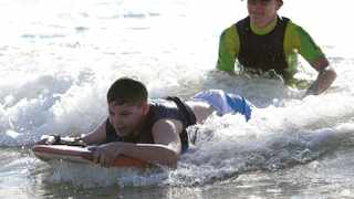 Experienced surfer Alison Taczalo trains Luke Lotter, 12, for surfing at South Beach in Durban. Lotter lives with a disability.Zanele Zulu.02/02/2015