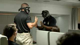 FEDERAL Air Marshals reenact a scene involving an unruly passenger. Picture: Washington Post photo by Monica Rodman.
