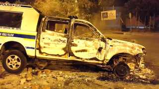 FEE BEARING - Cape Town - 150915 - A bunrt out police van in Masiphumelele after a vigilante attack - NO BYLINE