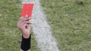 FILE - A referee showing a red card. Photo: Kim Kyung-Hoon/Reuters