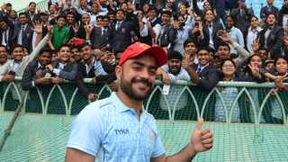 FILE - Afghanistan's Rashid Khan gestures with his fana during the third day of the only cricket Test match between Afghanistan and West Indies at the Ekana Cricket Stadium in Lucknow on November 29, 2019. Photo: Rohit Umrao/AFP