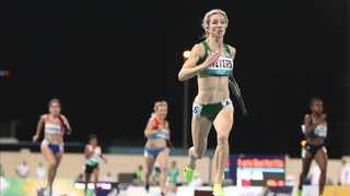 FILE - Anrune Weyers of South Africa running to victory in the women's 400m T47 final at the World Para Athletics Championships in Dubai, United Arab Emirates. Photo: Ali Haider/EPA