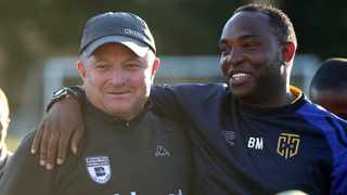 FILE - Benni McCarthy, Coach of Cape Town City FC (r) shares a joke with Gavin Hunt, Coach of Bidvest Wits during the pre season friendly. Photo:Chris Ricco/BackpagePix