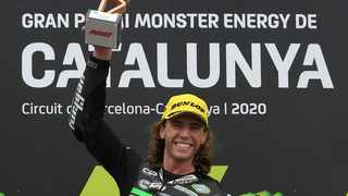 FILE - CIP Green Power's South African rider Darryn Binder celebrates on the podium after winning the Moto3 race of the Moto Grand Prix de Catalunya at the Circuit de Catalunya on September 27, 2020. Photo: Lluis Gene/AFP