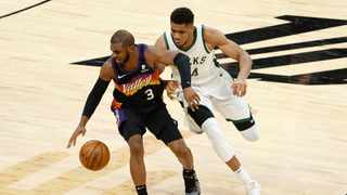 FILE - Chris Paul #3 of the Phoenix Suns handles the ball against Giannis Antetokounmpo #34 of the Milwaukee Bucks during the second half of their NBA game at Phoenix Suns Arena earlier this year. Photo: Christian Petersen/Getty Images/AFP