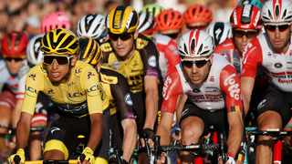FILE - Colombia's Egan Bernal, left, wearing the overall leader's yellow jersey, centre, races on the Champs Elysees during the Tour de France cycling race in Paris last year. Photo: Michel Euler/AP