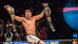 FILE - Dricus du Plessis celebrates with the EFC welterweight and middleweight championship belts. Photo: EFC