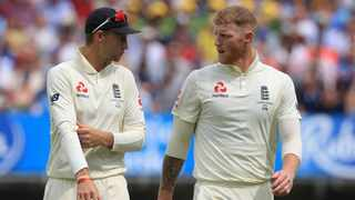 FILE - England's captain Joe Root chats with Ben Stokes during the fourth Ashes Test in 2019. Photo: Lindsey Parnaby/ AFP