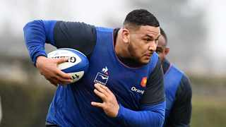 FILE- France's tight head prop Mohamed Haouas runs with a ball during a training session in March, 2020. Photo: Franck Fife/AFP