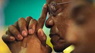 FILE - In this Thursday, Dec. 21, 2017, file photo of former South African Jacob Zuma, gestures as a new party leader addresses delegates during the closing of the ANC's elective conference in Johannesburg. The director of South Africa's National Prosecuting Authority says that former president Jacob Zuma will be prosecuted on 16 charges of corruption. Shaun Abrahams announced Friday that Zuma will be face charges including fraud, corruption, racketeering and money laundering. (AP Photo/Themba Hadebe, File)