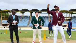 FILE - Kraigg Brathwaite of the West Indies tosses the coin as Dean Elgar of South Africa looks on ahead of the first Test at the Darren Sammy Cricket Ground. Photo: Randy Brooks/AFP